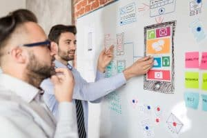 Designers drawing ux app development